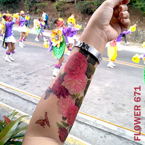 Peony flower temporary tattoo sticker on woman's arm on captured while on the street.