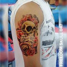 Load image into Gallery viewer, Freedom, skull, and roses temporary tattoo on a man's arm.