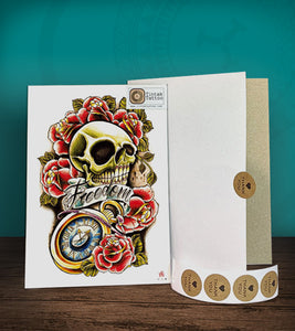 Tintak temporary tattoo sticker with skull and roses design, with its hard board packaging.