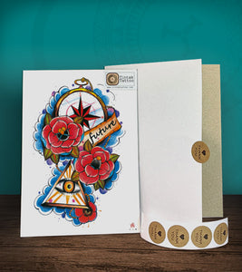 Tintak temporary tattoo sticker with the eye, roses, and compass design, with its hard board packaging.