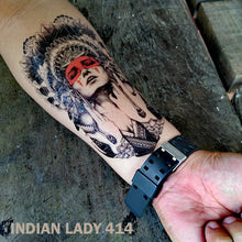 Load image into Gallery viewer, Man's arm with indian lady temporary tattoo, on top of a wooden table.