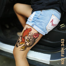 Load image into Gallery viewer, Woman's leg with two colored koi fish temporary tattoo sticker design and about to enter a car.