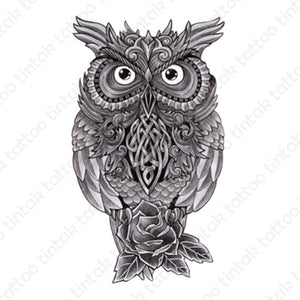 black and gray owl temporary tattoo design with rose flower below it.