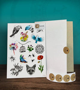 Tintak temporary tattoo with bird and flower designs, with its hard board packaging.