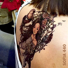 Load image into Gallery viewer, Woman's back with temporary tattoo sticker - animated girl inside the circled flowers with birds and feathers.