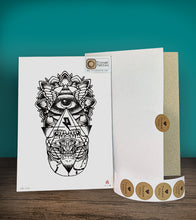 Load image into Gallery viewer, Tintak temporary tattoo sticker with the eye of providence design beside its packaging.