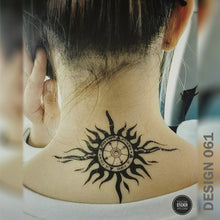 Load image into Gallery viewer, Tribal compass temporary tattoo on a woman's nape.