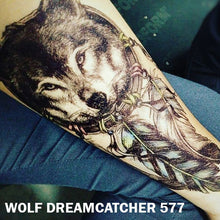 Load image into Gallery viewer, Temporary tattoo sticker placed on an arm with black and gray wolf dream catcher design.
