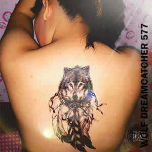 Woman's back with a wolf dream catcher temporary tattoo sticker.
