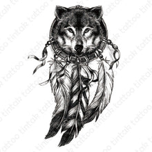 Load image into Gallery viewer, Black and gray dream catcher temporary tattoo design with the face of a wolf inside the circle.