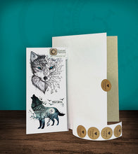 Load image into Gallery viewer, Tintak temporary tattoo sticker with moon wolf design, with its hard board packaging.