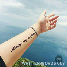 "Load image into Gallery viewer, ""Always keep the faith"" temporary tattoo placed on a woman's arm."