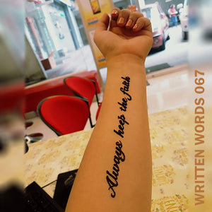 """Always keep the faith"" temporary tattoo placed on a woman's arm."