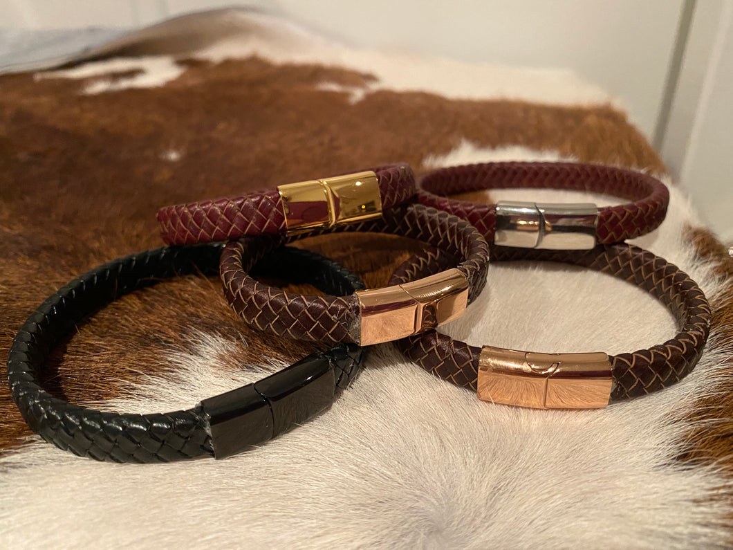 Leather plaited bracelets with slide clasps
