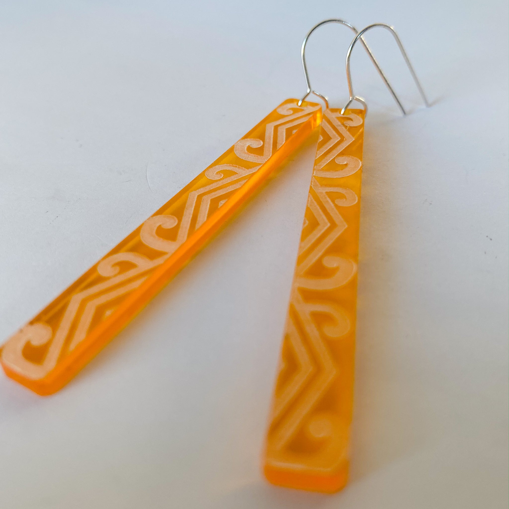 Earrings Orange tint, Koru long