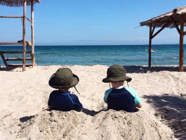 Boys looking out to sea