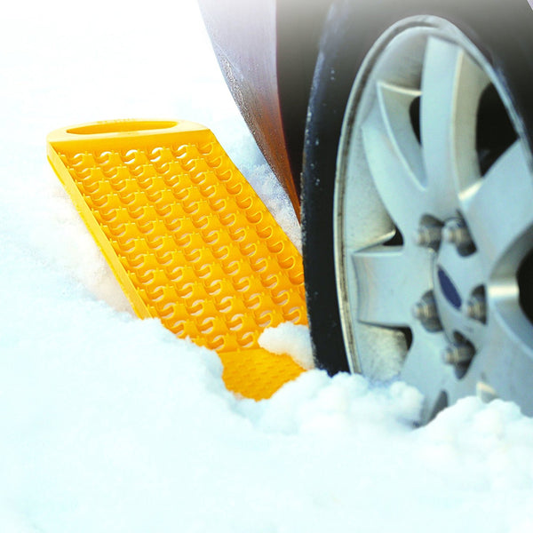 Image showing closeup of tire in thick snow with product molded in yellow sticking out from rear of tire.