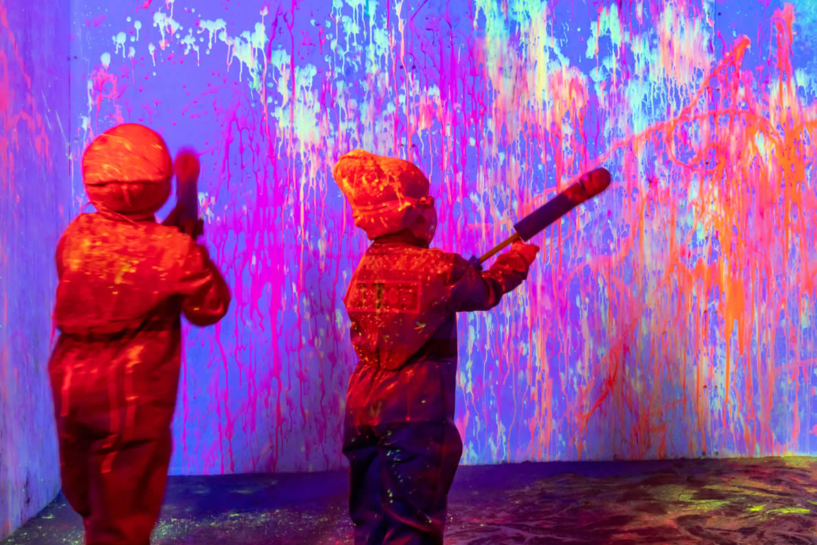 Children playing with Neon Paint in Kooties Coveralls - Messy Play!