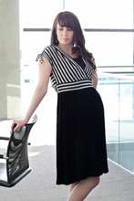 Load image into Gallery viewer, Woman wearing black and white striped dress