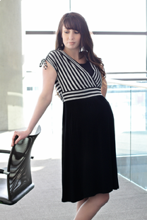 Woman wearing black and white striped dress