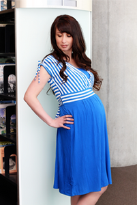 woman wearing blue and white striped dress