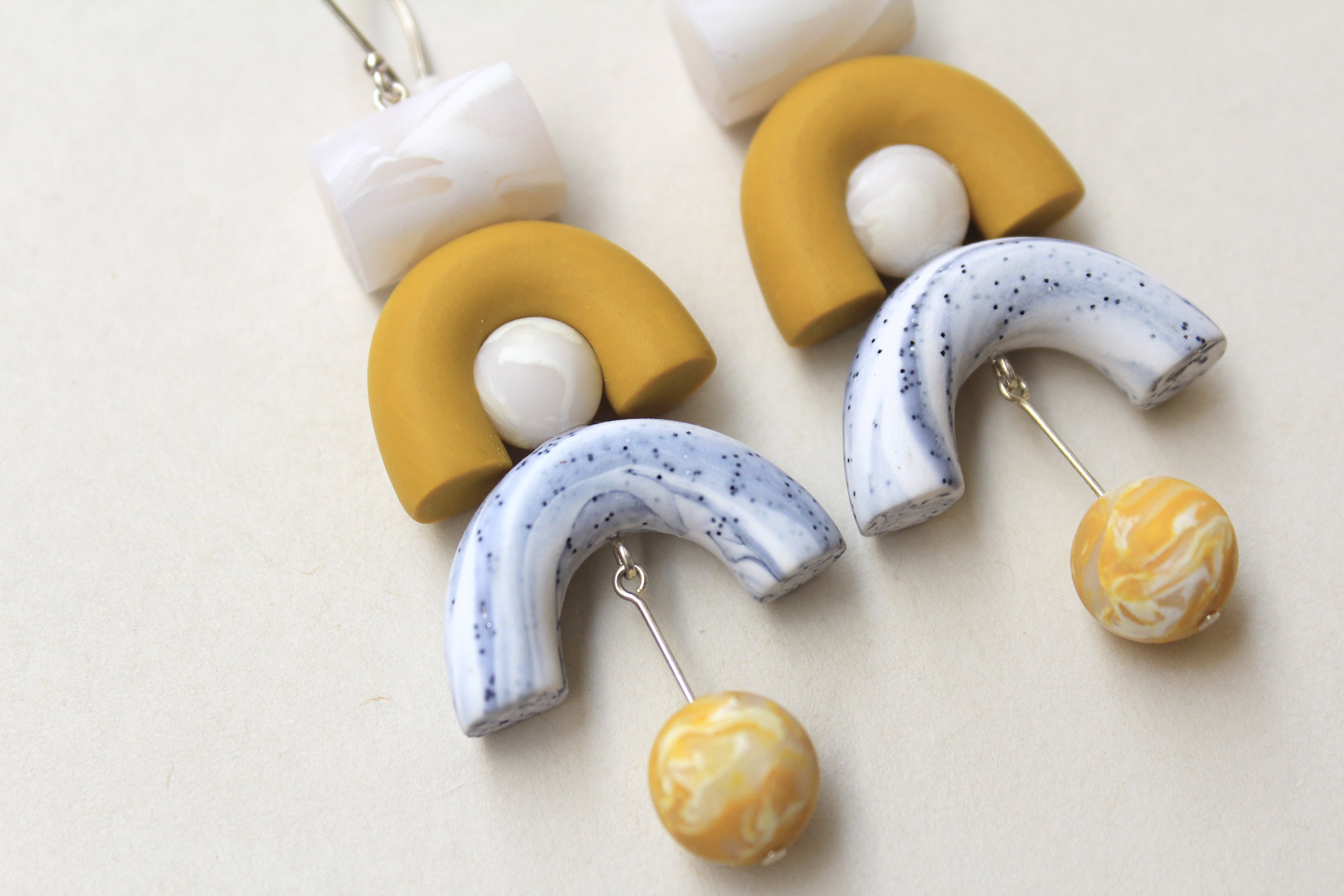Tsunja Geometric Earrings in mustard, marble white with hanging balll made of polymer clay, Ook Earrings