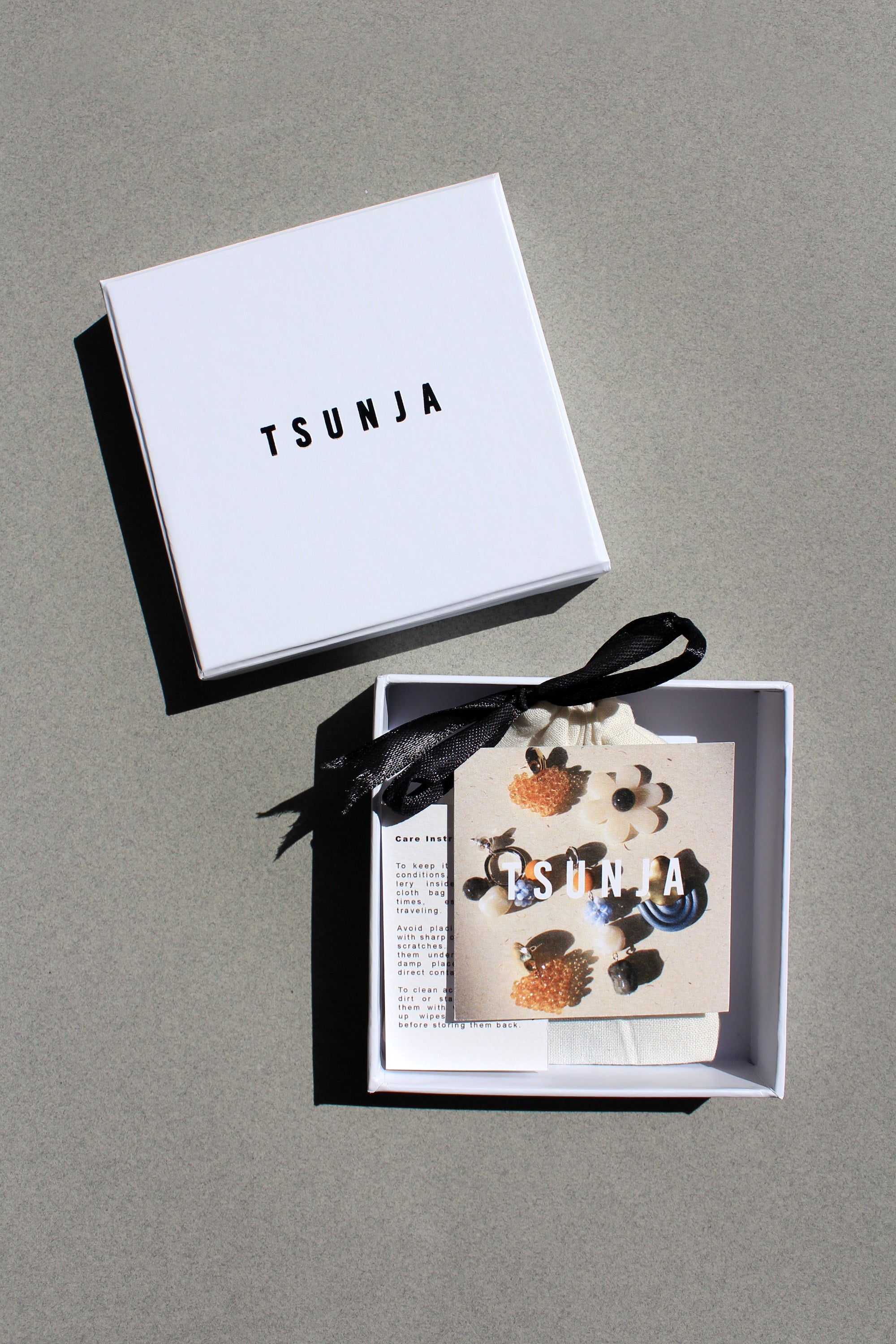 Tsunja box packaging with brand card, care instruction and pouch