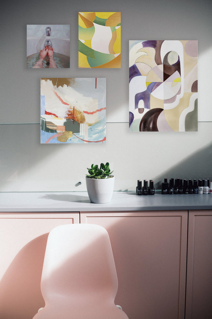gallery art wall with 4 artworks in a soft pink room