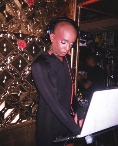 Ahmad, resident DJ at an event hosted by Brooklyn based Black trans led mutual aid For The Gworls at Luv Story
