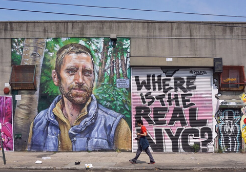 """largescale street art in Bushwick. Writing on a garage door asks """"where is the real NYC"""""""