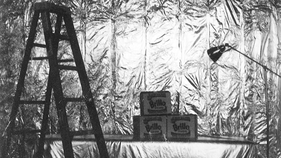 """Three of Andy Warhol's """"Brillo Boxes"""" in his tin foil wrapped East 47th street studio"""
