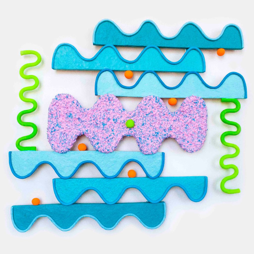 An original sculptural artwork, Wavy Vibrations, by New York artist Ryan Patrick Martin. Ryan creates colorful, fun, humorous sculptures that are full of movement and multi-sensory experiences