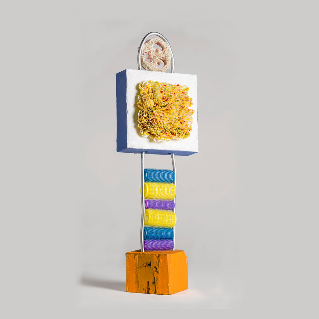 An original bright recycled found object mixed media sculpture by Fukuko Harris, an artist who has exhibited in New York, titled Loofah Tower 1