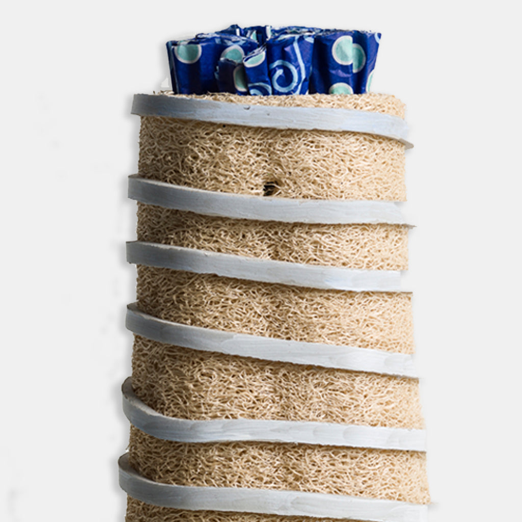 An original bright recycled found object mixed media sculpture by Fukuko Harris, an artist who has exhibited in New York, titled Loofah Tower 2
