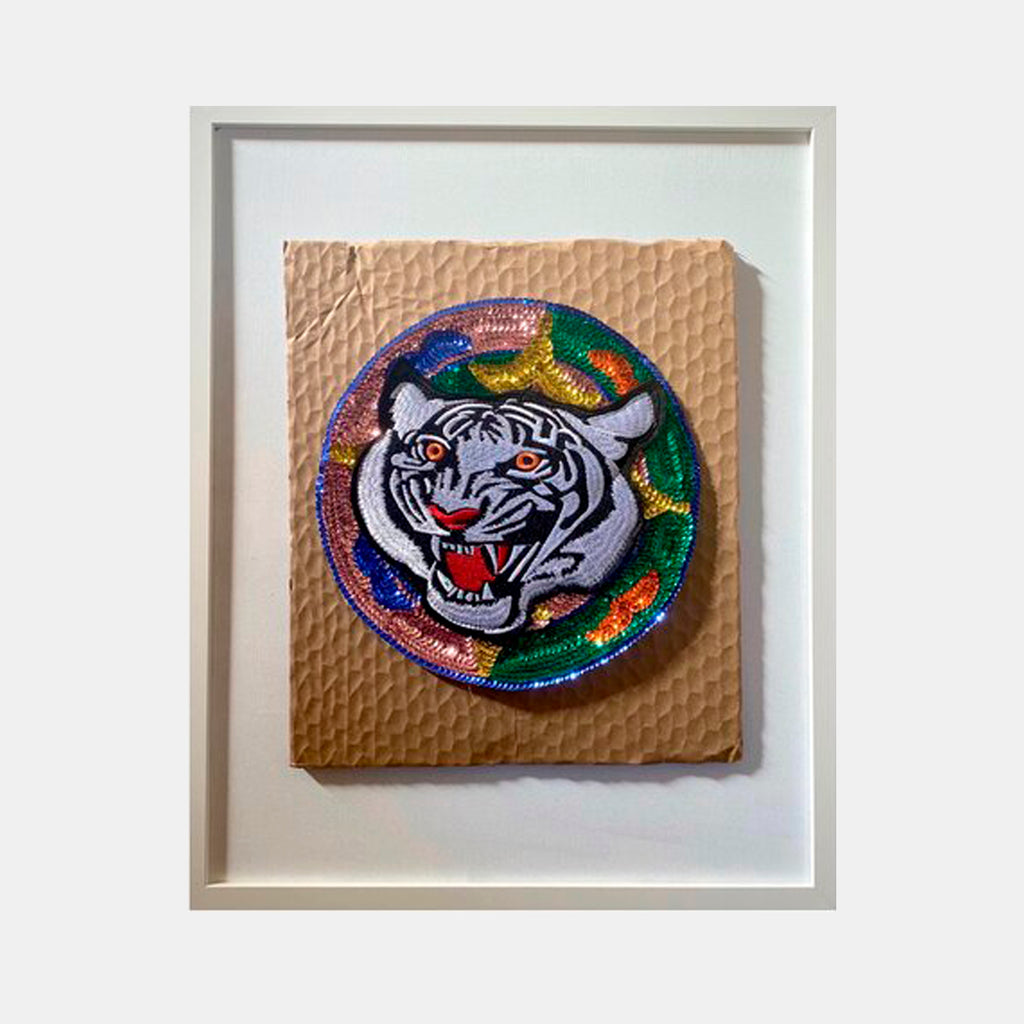 An original sequined tiger on cardboard painting by Katie Hector an artist who has exhibited in New York, titled Crumbcatcher