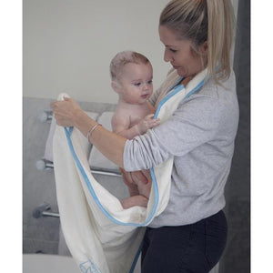 how to wrap your baby in a towel after bathtime - with the Cuddledry handsfree apron towel