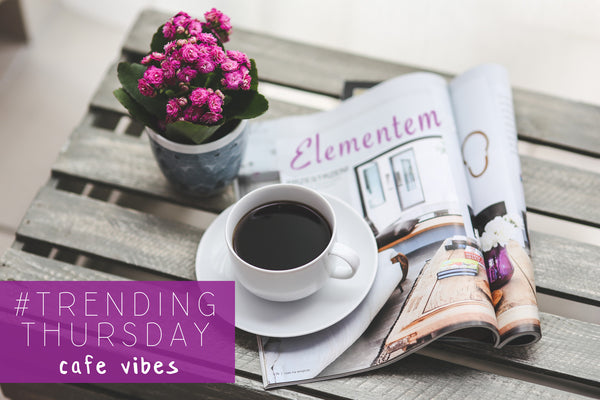 Trending Thursday coffee and magazine with flowers on a coffee table