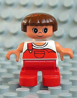 Duplo Figure, Child Type 2 Girl, Red Legs, White Top with Red Overalls with one Strap