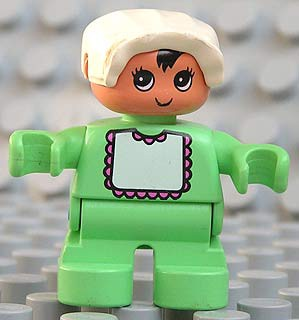 Duplo Figure, Child Type 2 Baby, Light Green Legs, Light Green Top with White Bib with Dark Pink Lace, White Bonnet