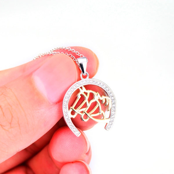 """Fellowship"" Horseshoe Silver Necklace held by fingers - Horse Deco Store"