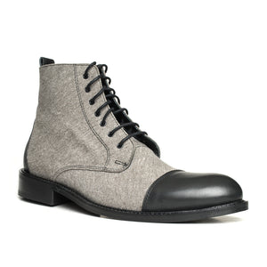 The Gentleman Boot is made of 100% genuine cowhide leather combined with linen for a classic look.  This model uses 100% fine black calf leather on the toe and heel cup.  The bottom sole is made of rubber and thermo blended 1st class material.