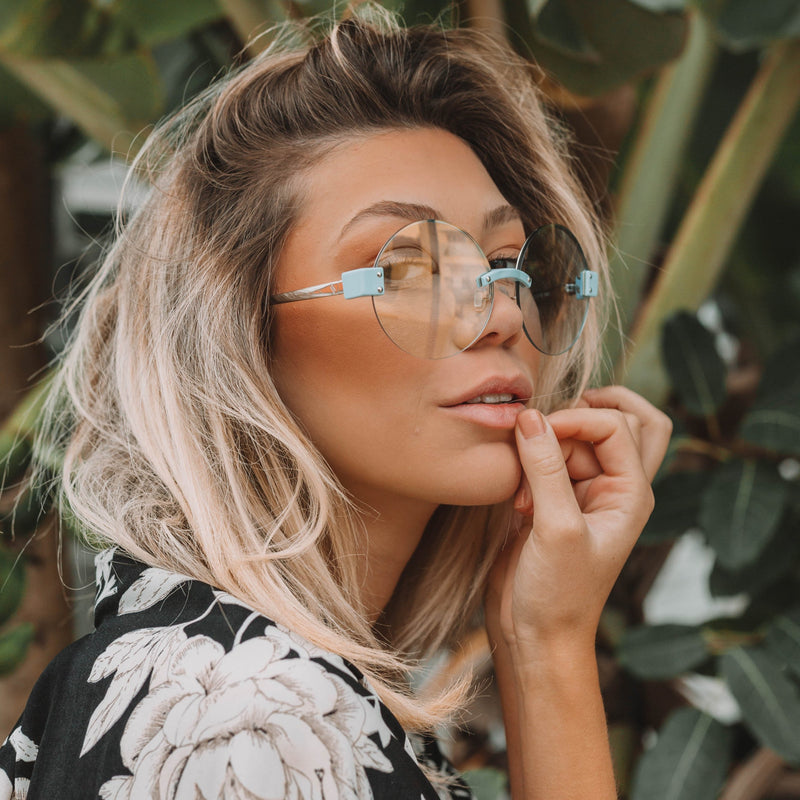 Round oversized sunglasses with light colored lenses