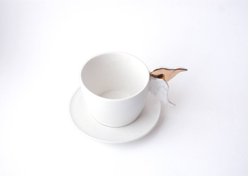 Porcelain cup with golden wings