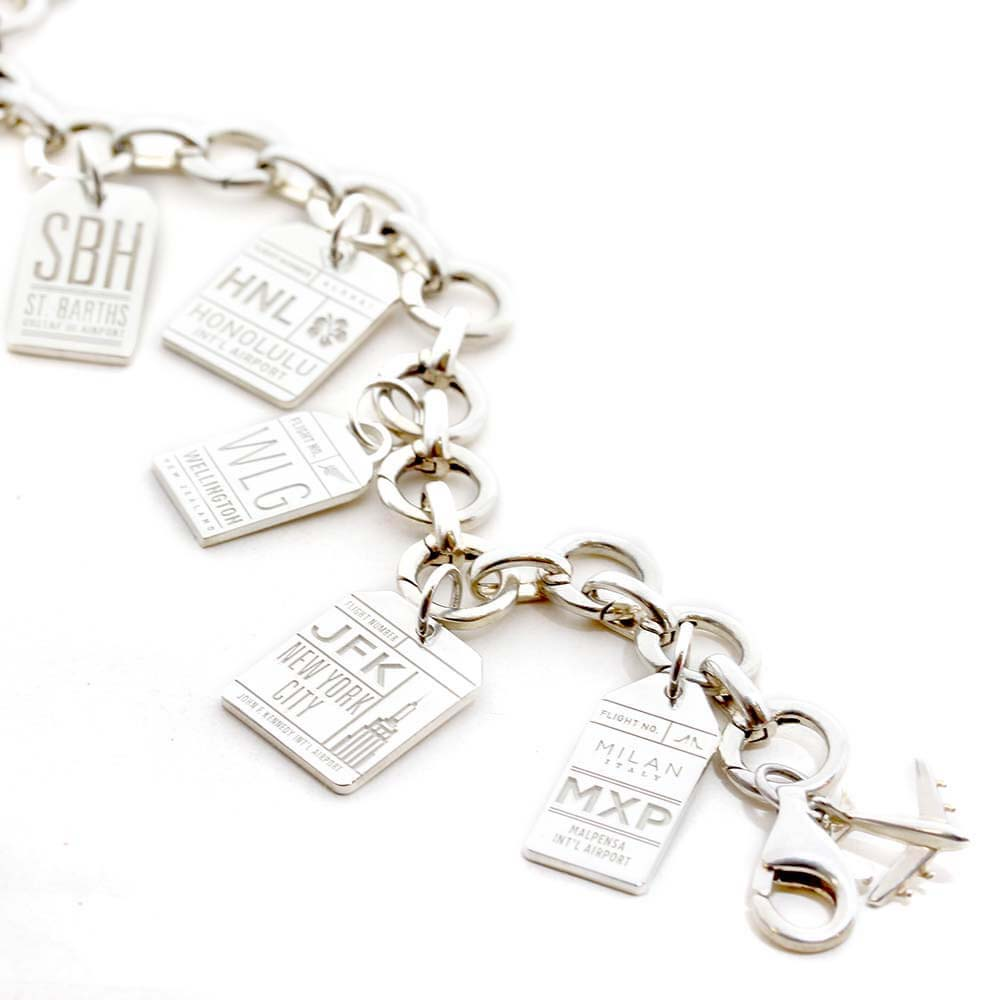 STERLING SILVER CHARM BRACELET WITH 12 LUGGAGE TAG CHARMS - JET SET CANDY