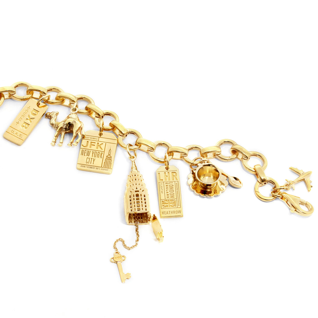 GOLD ADVENTURE CHARM BRACELET WITH 6 CHARMS (MINI PLANE SHIPS JUNE) - JET SET CANDY