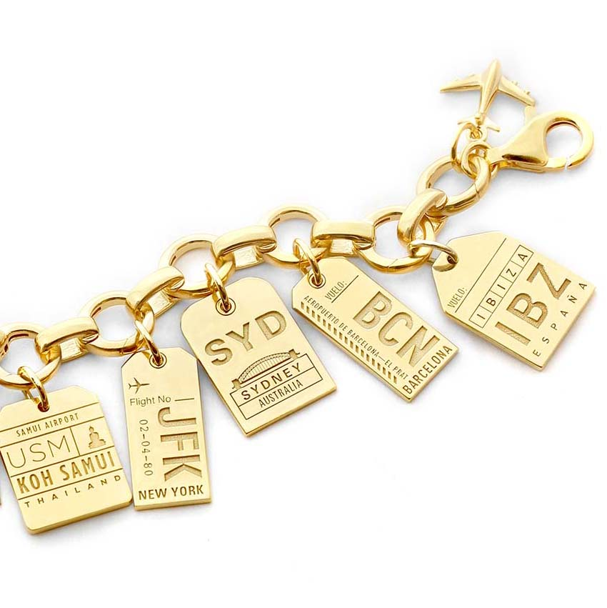 GOLD CHARM BRACELET WITH 5 LUGGAGE TAG CHARMS (SHIPS LATE MAY)