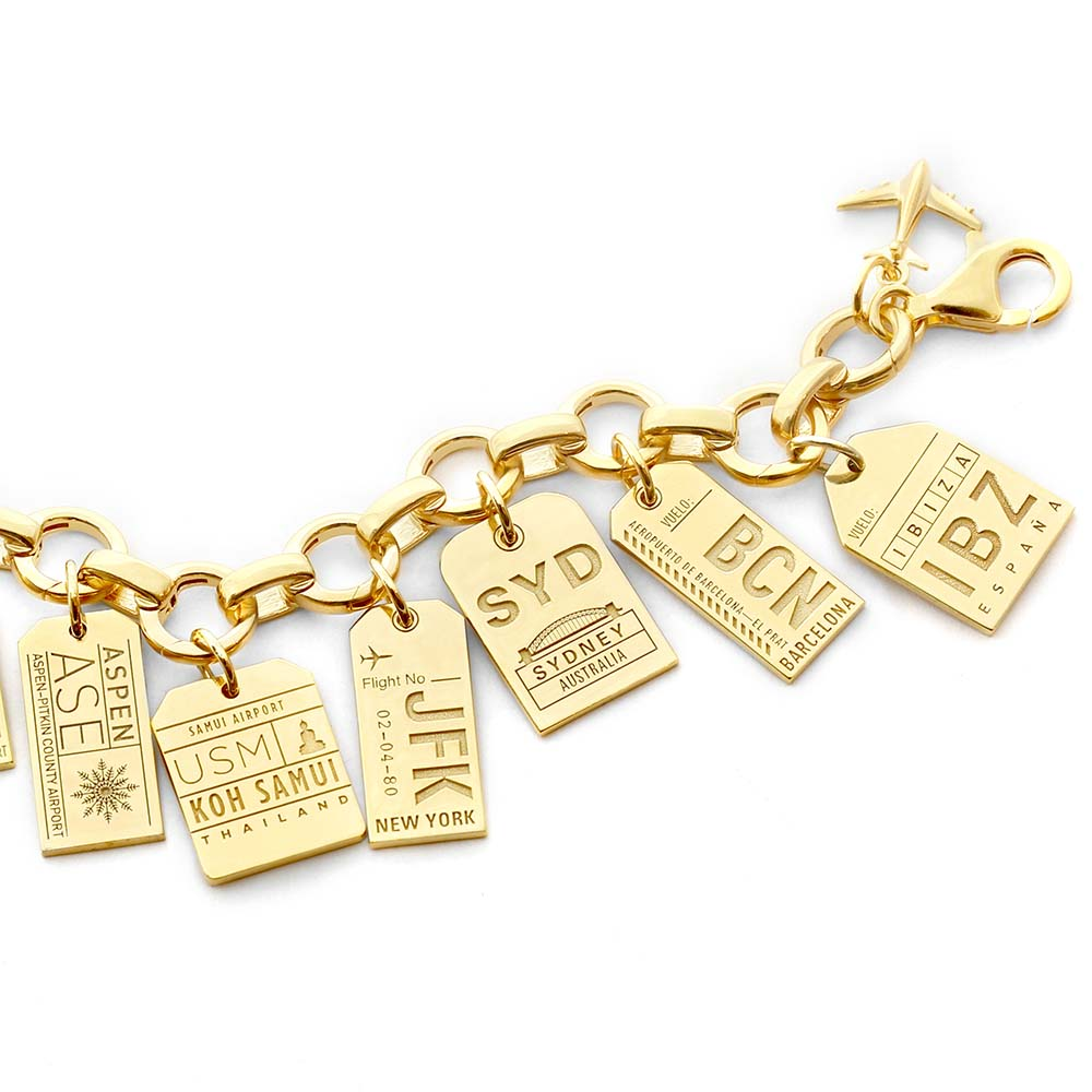 GOLD CHARM BRACELET WITH 12 LUGGAGE TAG CHARMS - JET SET CANDY