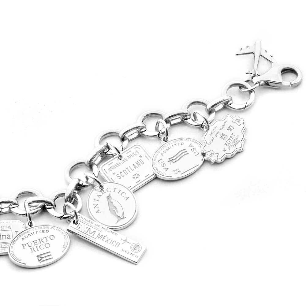 STERLING SILVER CHARM BRACELET WITH 12 PASSPORT STAMP CHARMS - JET SET CANDY