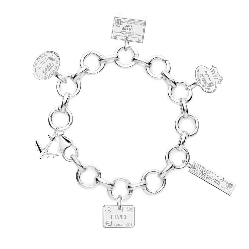 STERLING SILVER CHARM BRACELET WITH 5 PASSPORT STAMP CHARMS - JET SET CANDY