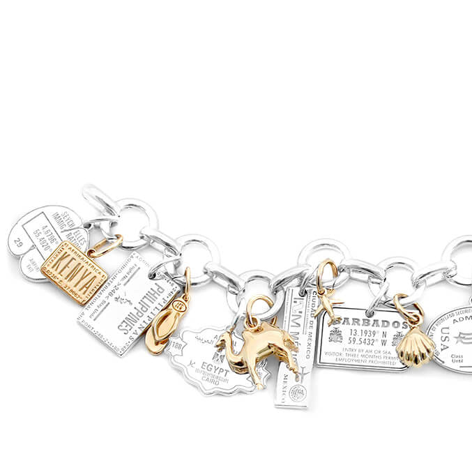 SILVER AND SOLID GOLD CHARM BRACELET
